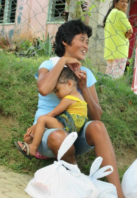 En glad kvinna i Masumbang.